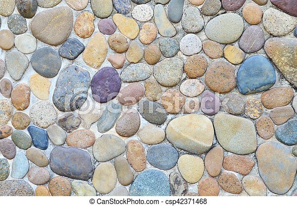 Pebble Stone In Cement Wall - csp42371468