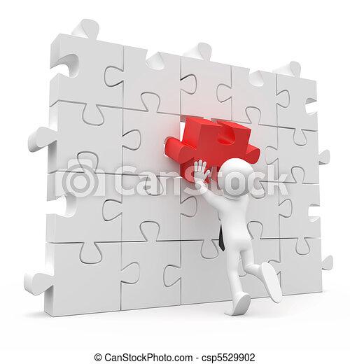 Hombre poniendo una pieza roja - csp5529902