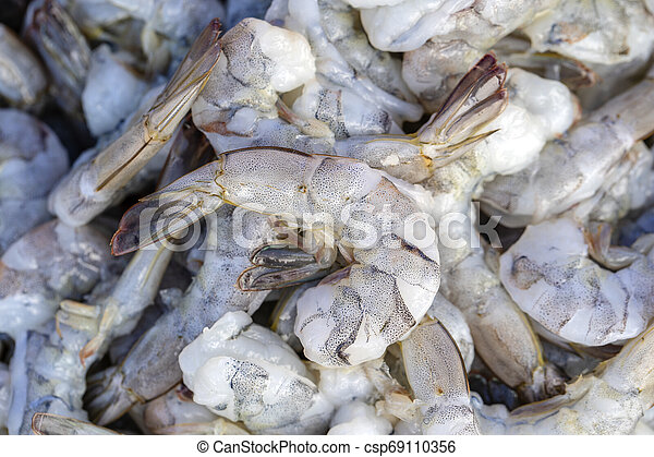 Peeled sea shrimp at street market in Thailand. Seafood concept. - csp69110356