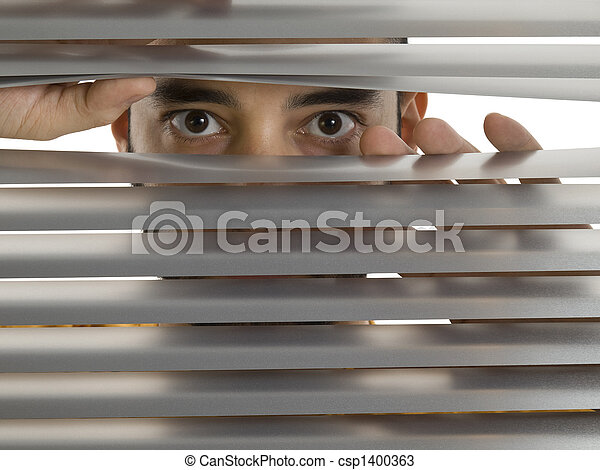 Peeping Tom A Man Looks To The Camera Through The Blinds
