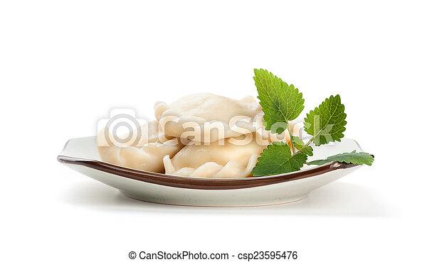 pelmeni on a plate - csp23595476