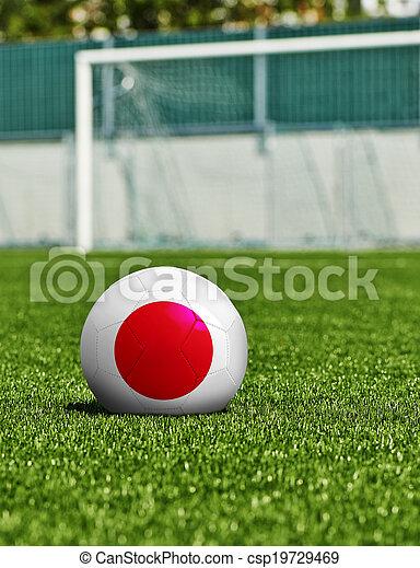 Bola de fútbol con bandera japonesa en el césped del estadio - csp19729469