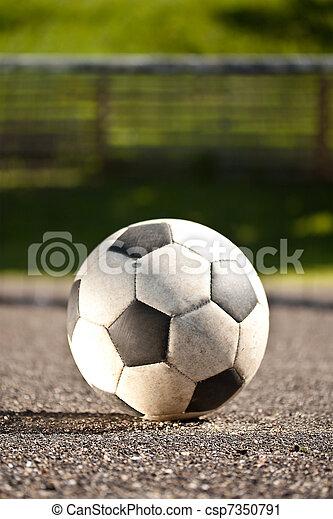 Bola de fútbol en asfalto - csp7350791