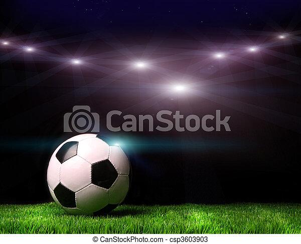 Bola de fútbol en la hierba contra el negro - csp3603903