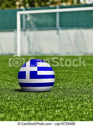 Bola de fútbol con bandera de Grecia en el césped del estadio - csp19729468