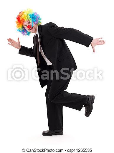 Feliz hombre de negocios con peluca de payaso - csp11265535