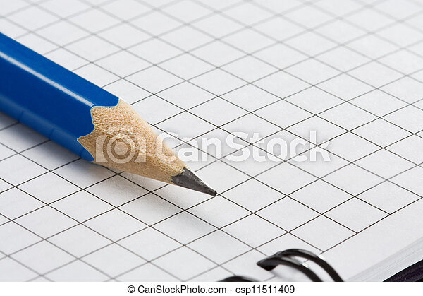 pencil on checked notebook - csp11511409