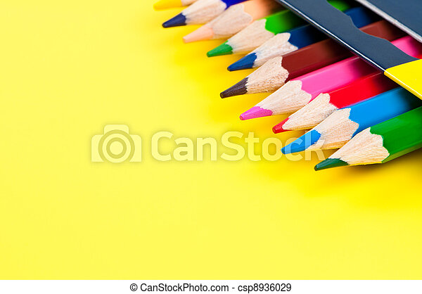 Pencils on yellow background. - csp8936029