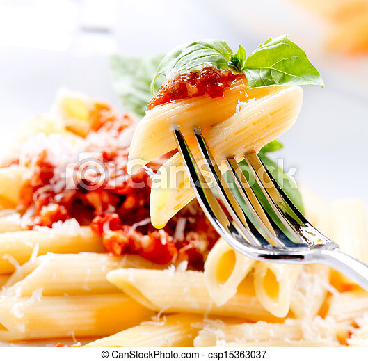 Penne Pasta with Bolognese Sauce, Parmesan Cheese and Basil - csp15363037