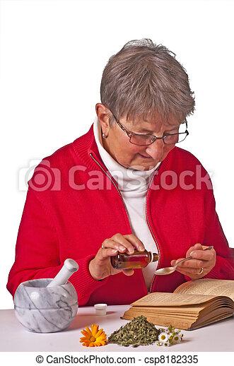 pensioner taking herbal drops - csp8182335