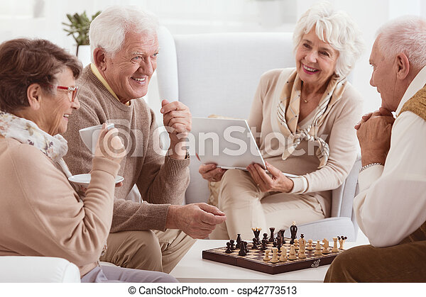 Pensioners playing chess - csp42773513
