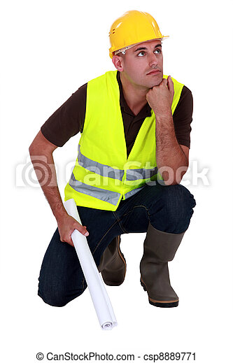 Pensive laborer crouching on white background - csp8889771