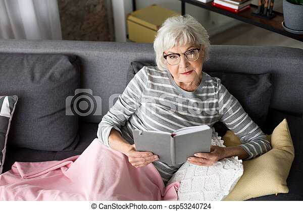 Pensive Lady Reading Book At Living Room Top View Of Old Female Pensioner Enjoying Literature She Is Thoughtfully Looking Canstock