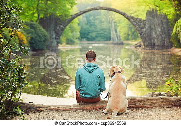 Pensive man sitting with his dog - csp36945569