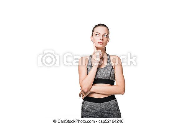 pensive sporty girl - csp52164246