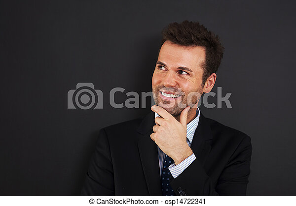 Pensive young businessman looking on side  - csp14722341