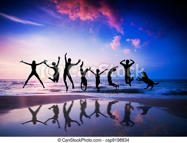 People and dog jumping on the beach. Happiness - csp9198834