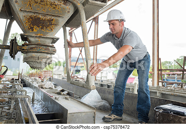 people are cementing the cement in the factory - csp75378472