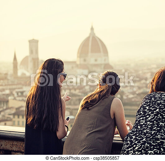 People at sunset watching the view of Florence. - csp38505857