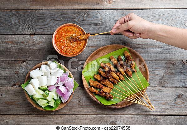 People eating sate - csp22074558