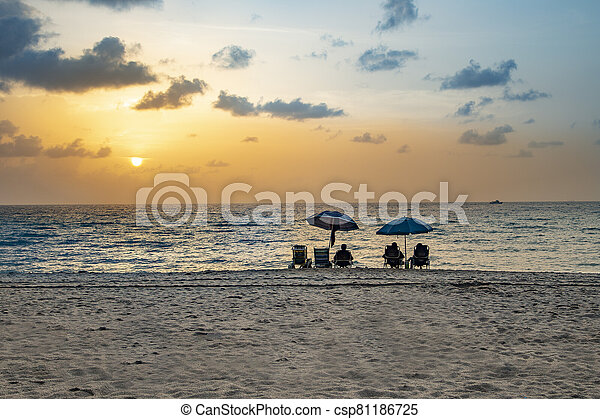 people enjoy the sunset at south beach, Miami - csp81186725