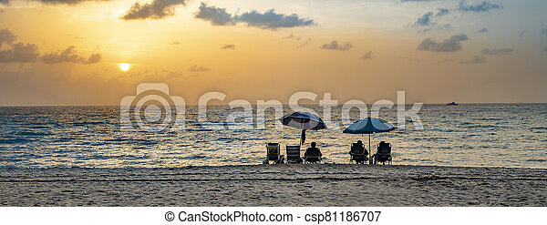 people enjoy the sunset at south beach, Miami - csp81186707