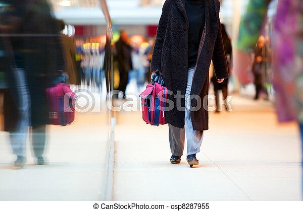 People in rush in shopping mall - csp8287955