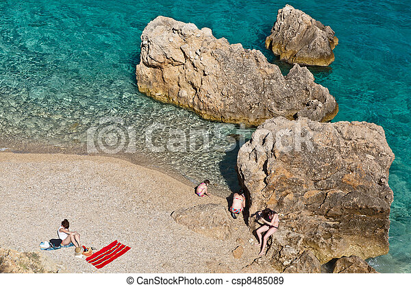 People on the Rocky Beach in Croatia - csp8485089