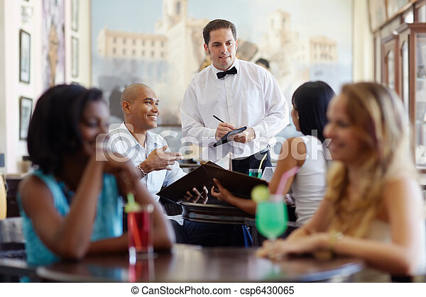 people ordering meal to waiter in restaurant - csp6430065