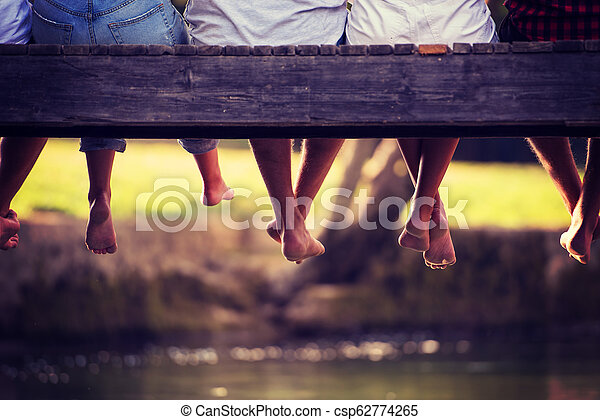 people sitting at wooden bridge - csp62774265