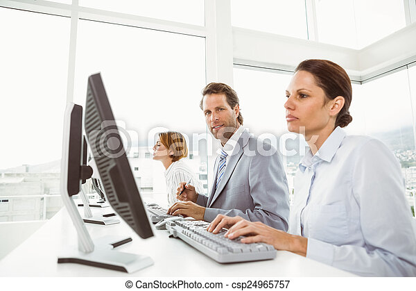 People using computers in office - csp24965757