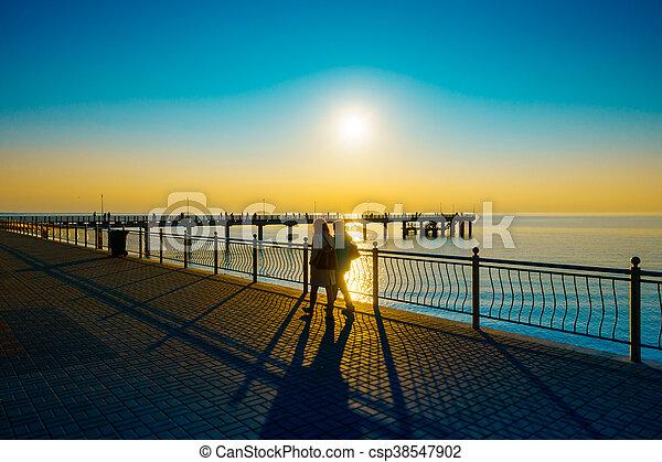 People walking on the embankment at Baltic Sea coast - csp38547902