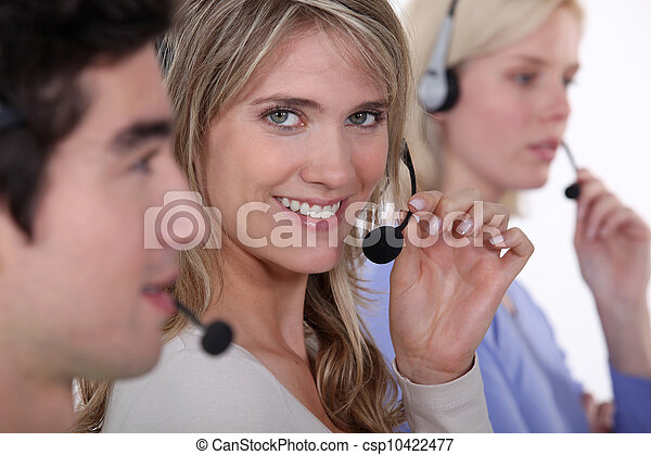 people working in a call center - csp10422477