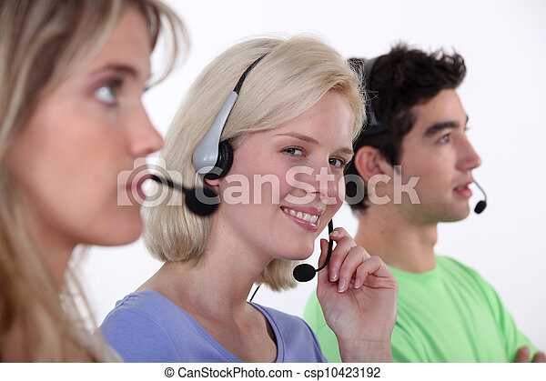 people working in a  call center - csp10423192