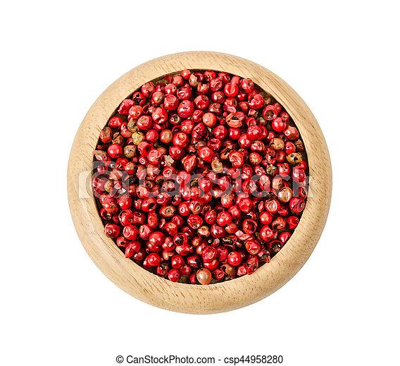 Pepper red peppercorns in wooden dish. - csp44958280