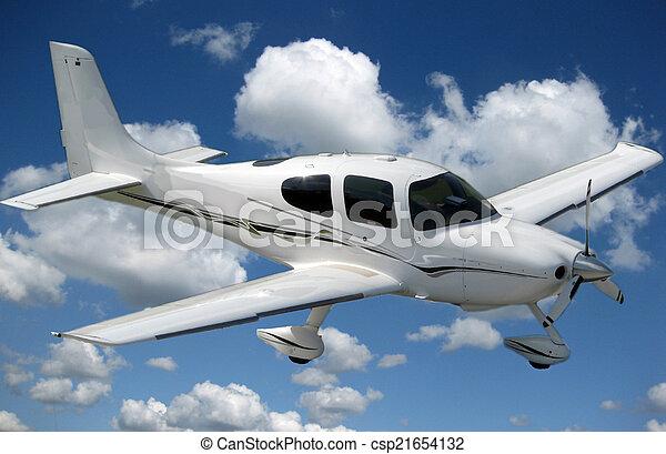 Un pequeño avión privado volando - csp21654132