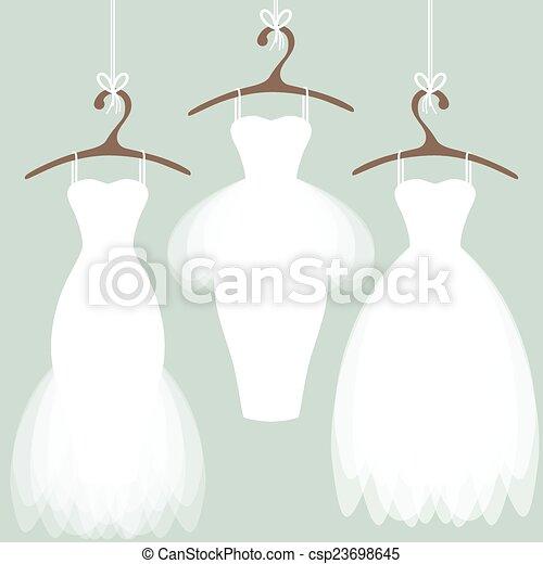 Vestidos de boda en perchas - csp23698645