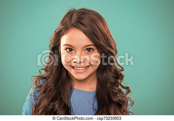 Perfect Curling Hair Kid Girl Long Healthy Shiny Hair Kid Happy Cute Face With Adorable Curly Hairstyle Stand Over Blue