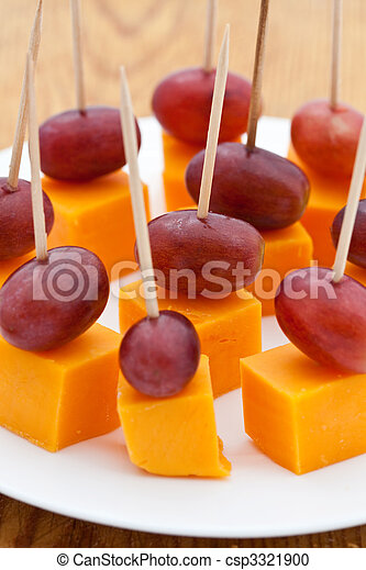 Perfect party snacks. Cheese cubes with red seedless grapes - csp3321900