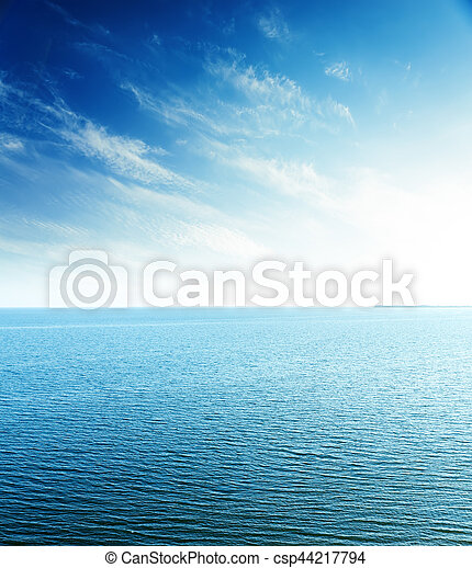 perfect sunset in blue sky over sea. aerial view - csp44217794