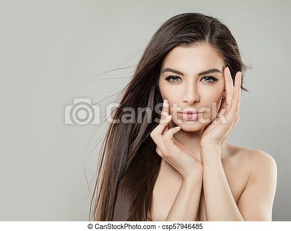 Perfect Young Woman with Healthy Skin and Long Brown Hair. Attractive Model on Background - csp57946485