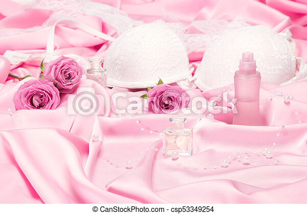 19ad58d66 Perfumes with roses and women underwear on pink silk. choice of ...