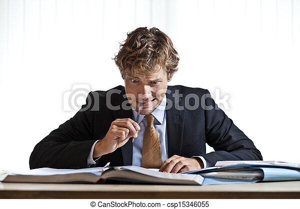 Perplexed businessman working on problem - csp15346055