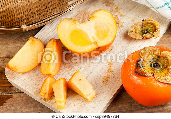 Persimmon Yellow Color Fruits Persimmon Yellow Color Ripe Split Fruits On Wood Table