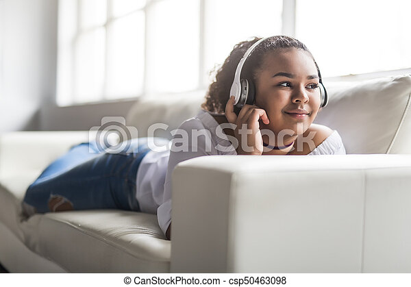 person african young woman relaxing at home - csp50463098