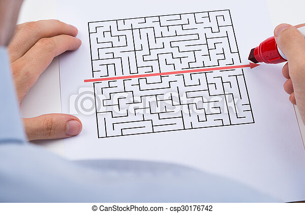 Close up of person drawing straight red line over maze with stock person drawing straight red line over maze csp30176742 malvernweather Choice Image