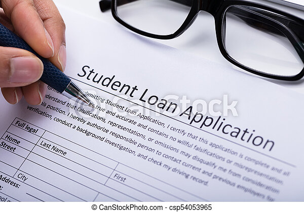 Person Filling Student Loan Application Form CloseUp Of A  Stock