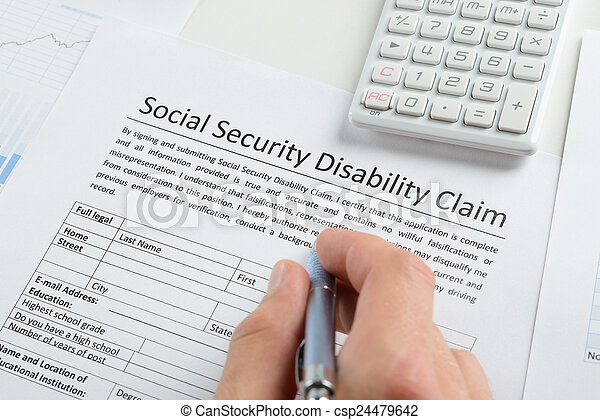 Person Hand With Pen Filling Social Security Disability  Stock