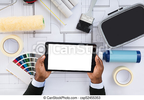 Close up of a person holding blank screen digital tablet on stock person holding blank screen digital tablet on blueprint csp52455353 malvernweather Choice Image