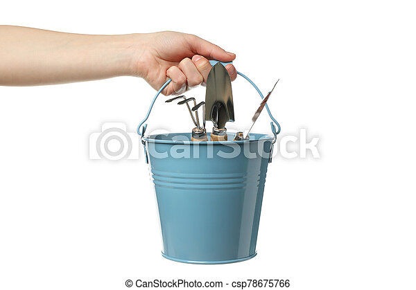 Person holds bucket with gardening tools, isolated on white background - csp78675766